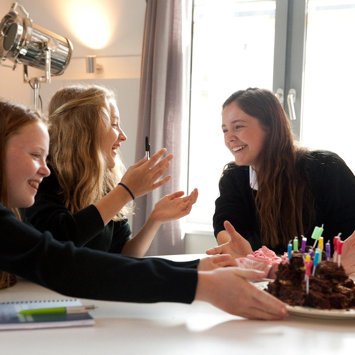 Girls-boarding-with-birthday-cake.jpg